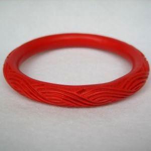 Red Cinnabar Bangle Bracelet with Braided Grass Design