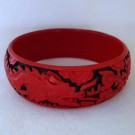 Medium Cinnabar Bracelet: Red and Black Dragon and Phoenix Pattern--Slightly under 1 in wide
